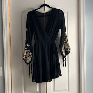 Beautiful wrap dress with embroidered gold sleeves